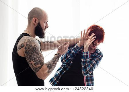Muscular Bearded Man Beating His Redhead Wife