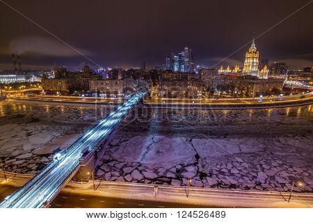 Smolensky Metro Bridge and river at winter night in Moscow, Russia, long exposure