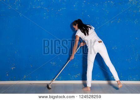 the nice girl sweeps the room in studio