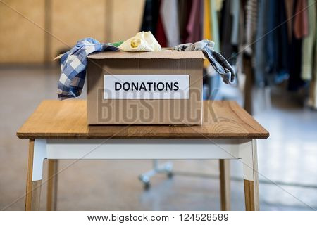 Donation box on a wooden table in the office
