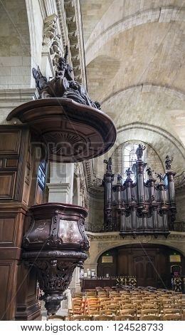 Bordeaux France - March 26 2016. The pipe organ in nave of Notre-Dame church. Notre Dame is the most baroque and romanesque style in Bordeaux Aquitaine. France.