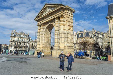 Bordeaux, France - March 26, 2016. People walking near to Porte d'Aquitaine (local name) Aquitaine gate at Place de la Victoire. Bordeaux, France.