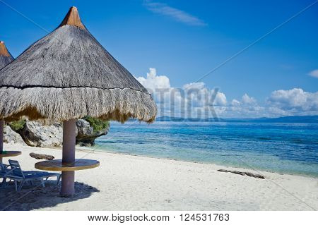 Tropical beach landscape with deckchair and parasol, Philippines