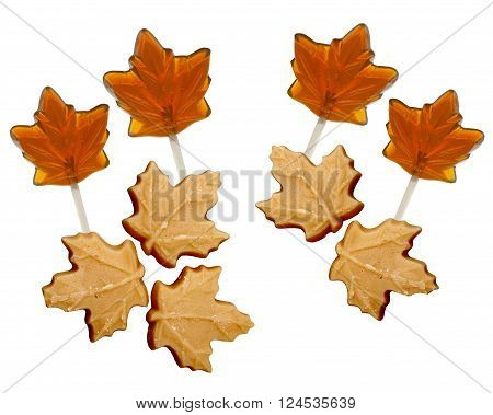 Maple sugar Candies and Lollipops on a white background