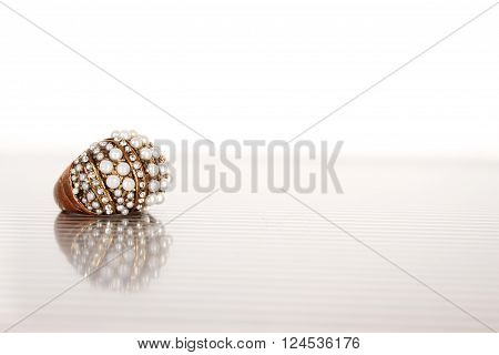Close-up of a large ring with pearls. Isolate