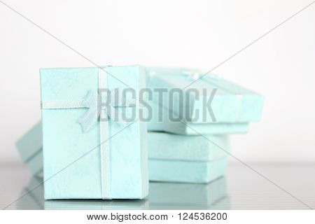 Close-up of a lot of small gift boxes for jewelry