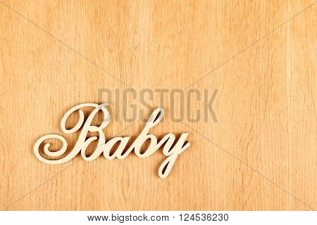 Closeup wooden words Baby on a wooden background