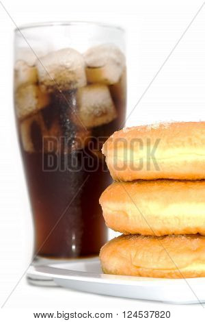 black drink (cola) and donuts and sugar over lettuce over white background