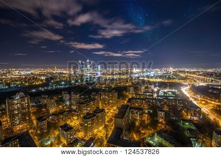 Night view of residential district with illumiantion and starry sky in Moscow, Russia