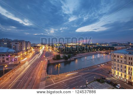 Serafimovich Street, Small stone bridge and Kremlin far away in Moscow evening, long exposure