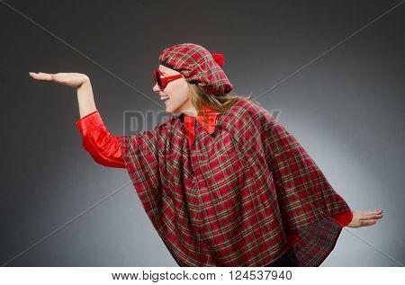 Woman wearing traditional scottish clothing
