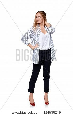 Full length of beautiful blond fashion model posing over white background looking to the side at blank copy space