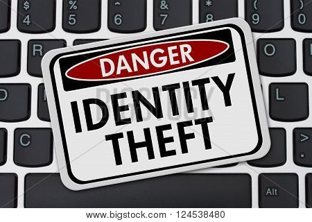 Identity Theft Danger Sign, A danger sign with text Identity Theft on a keyboard