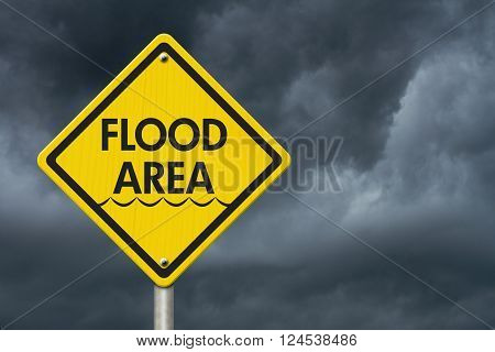 Yellow Warning Flood Area Highway Road Sign Red Yellow Warning Highway Sign with words Flood Area with stormy sky background