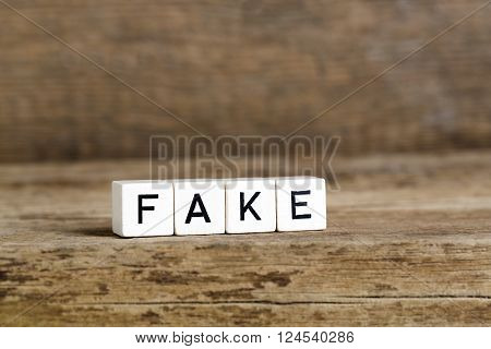 The Word Fake Written In Cubes