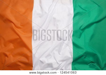 National flag of Ivory Coast as a background