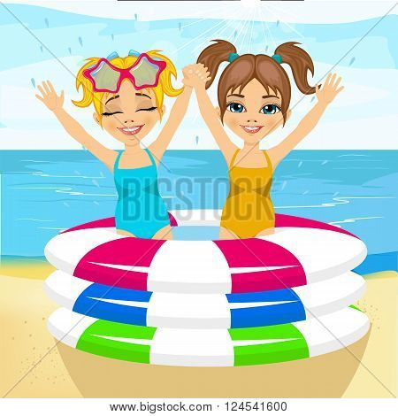 cute little brother and sister with raised arms swimming in inflatable pool at the beach
