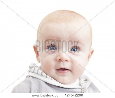 Baby with blue eyes looking to the camera and smiling, isolated on white background