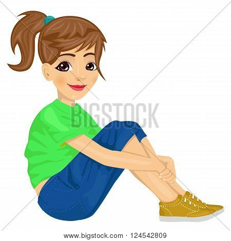 young teenager girl sitting on the floor isolated over white background