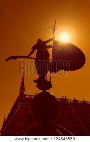 Sun of Andalusia. Silhouette of Giraldillo - famous weathervane 16th century, Sevilla, Spain
