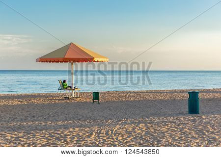 Beach at the sea with the umbrellas.