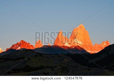 First rays of sunrise on Mount Fitz Roy Patagonia Argentina Los Glaciares National park