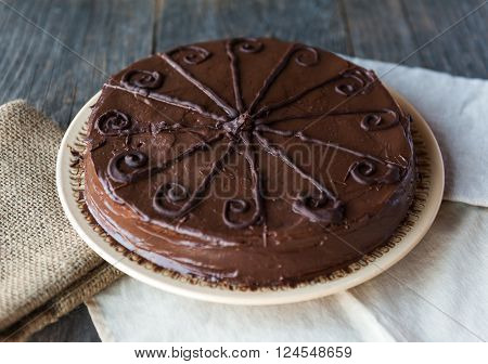 Details of a homemade chocolate cake with chocolate frosting