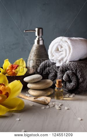 SPA still life. Orchid flower towel aroma oils and zen stones