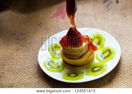 Pancakes With Strawberry Cream And Kiwi Fruit