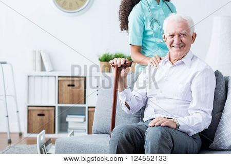 Happy Senior Disabled Man And Caregiver