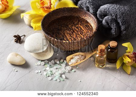 Spa set closeup. Spa composition with sea salt flowers and massage oil.
