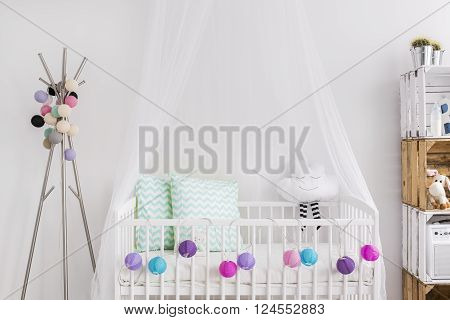 Shot of a bed in a modern baby room