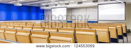 Modern medical university with spacious lecture hall with two screens