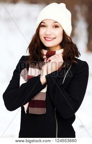 Pretty girl posing outdoors