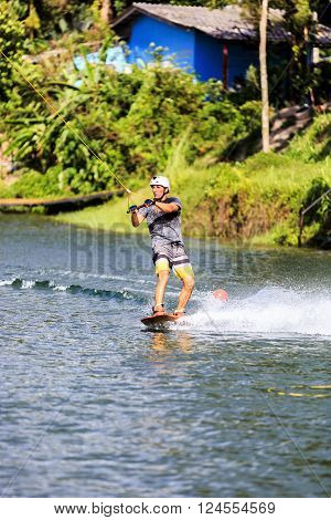 Young Man Wakeboarding in action. Phuket Thailand