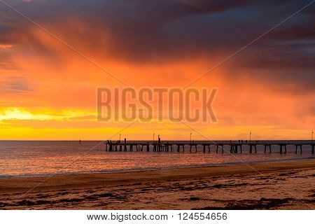 Stormy sunset above Glenelg Jetty South Australia