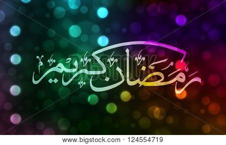 Arabic Islamic Calligraphy of text Ramadan Kareem on colourful defocused bokeh lights background.