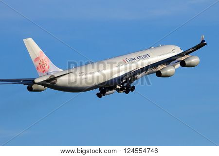 AMSTERDAM-SCHIPHOL - FEB 16, 2016: China Airlines Airbus A340-313 take-off from Schiphol airport
