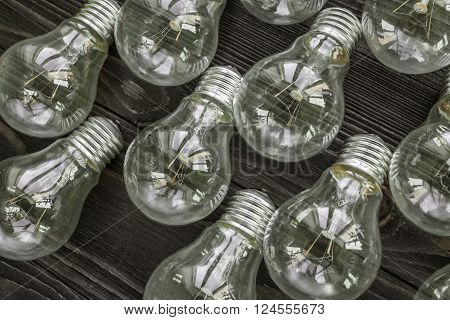 incandescent lamps on the wooden rustic background