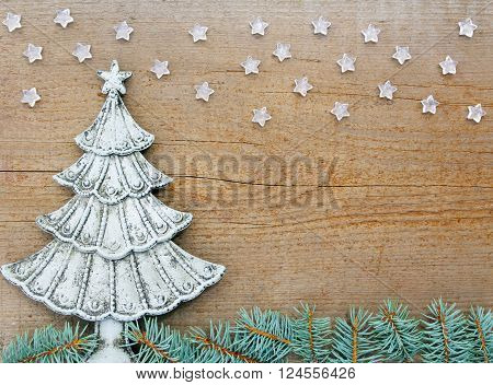 fir Fir branch and stars on old wooden table