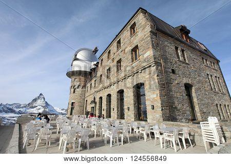 ZERMATT, SWITZERLAND- Nov 14, 2015: Tourists at Gornergrat viewpoint on Matterhorn mountain on Nov 14, 2015 in Zermatt , Switzerland. It is one of the most popular mountain resorts in Switzerland.