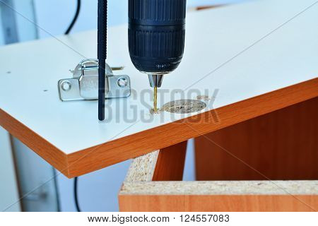 Hinge is assembled on kitchen cabinet door