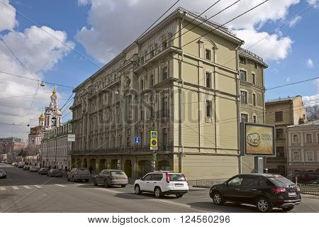 MOSCOW, RUSSIA - MARCH 21, 2016: View of the apartment building engineer Osip Vilner, Staraya Basmannaya Street, 12, Building 1, against the backdrop of the Temple of the Martyr Nikita, landmark