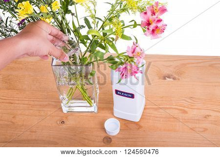 Add Liquid Bleach Into Vase With Water To Keep Flowers Fresher