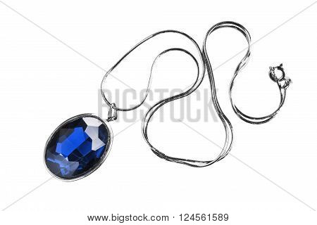 Blue sapphire medallion on silver chain isolated over white