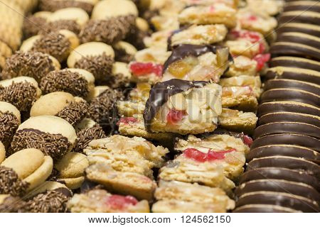 variety of decorated sweet pastry with chocolate and almonds