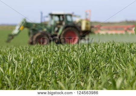 Tractor Spraying Green Field - Agriculture Background