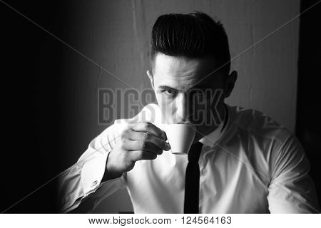 Young Man Drinks Coffee