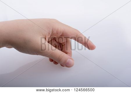 Hand pointing gesture on a white background