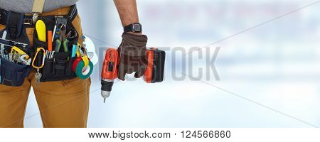 Builder handyman with a drill.